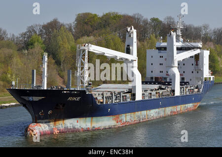 General Cargo Ship Rike passing the Kiel Canal. - Stock Image