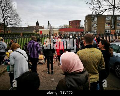 Glasgow, UK. 29th Mar, 2019. Parents collect their primary school children early as the spring break school holidays effectively start today. Credit: Pawel Pietraszewski/Alamy Live News - Stock Image