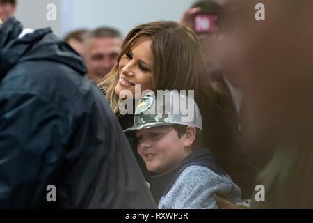 U.S First Lady Melania Trump a young victim at the Providence Baptist Church relief center March 8, 2019 in Smiths Station, Alabama. The region was hit by a tornado on March 3rd killing 23 people. - Stock Image