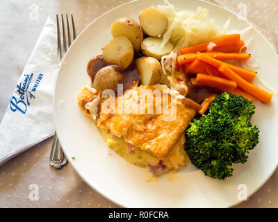 Set lunch at Elizabeth Botham's famous café in Whitby, a ham and chicken pie with new potatoes, carrots, white cabbage, broccoli and gravy. - Stock Image
