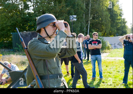 ENSCHEDE, THE NETHERLANDS - 01 SEPT, 2018: German soldier watching through binoculars during a military army show. - Stock Image