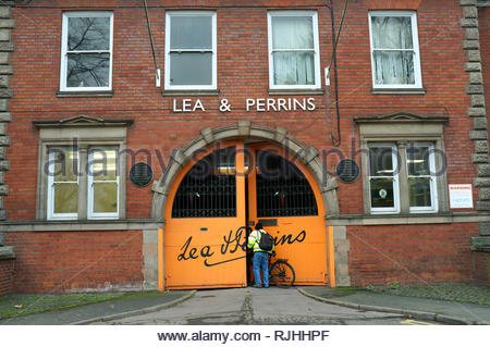 A worker enters the Lea & Perrins Worcestershire Sauce factory in Midland Road, Worcester, UK. - Stock Image