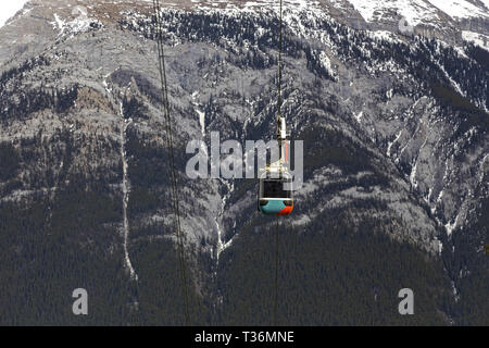 Sulphur Mountain Gondola Cable Car Cabin with Rundle Mountain Slopes in the Background, Banff National Park, Canadian Rockies - Stock Image
