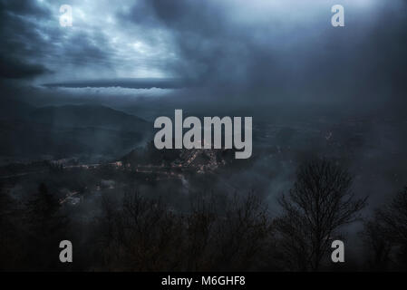 Dark landscape over the ancient little village of Sacred Mount of Varese in cloudy afternoon - Stock Image