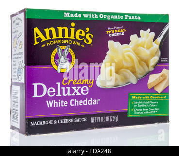 Winneconne, WI - 11 May 2019 : A package of Annies creamy deluxe white cheddar macaroni and cheese on an isolated background - Stock Image