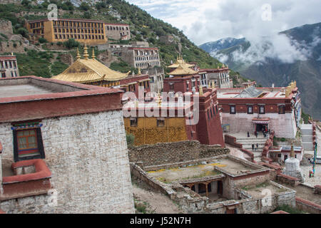 Rooftops of Ganden Monastery complex decorated with golden pinnacles and dhvajas, Lhasa, Tibet, shot in 2007 - Stock Image