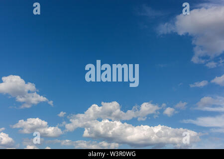 Sky with cloudscumulus clouds on clear blue sky before rain - Stock Image