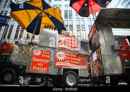 Hot dog and pretzel carts in midtown Manhattan, New York, NY, USA - Stock Image