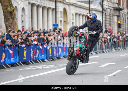Moto Stunts International motorbike display team at London New Year's Day Parade. Motorcycle in Whitehall. Alistair Ryder of Stunted Reality - Stock Image