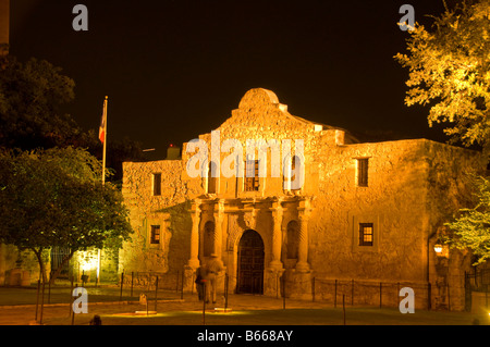 The Alamo mission, historic shrine monument at Alamo Plaza night with dark background San Antonio Texas TX - Stock Image