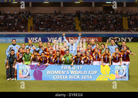 Spain squad in National Stadium pitch, posing with second place medals. - Stock Image