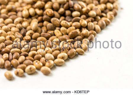 Selective focus on pile of soya beans on the white marble background. - Stock Image