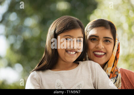 Portrait happy mother and daughter - Stock Image