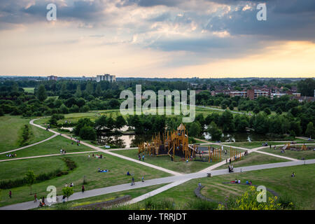 London, England, UK - June 18, 2017: Families play at a playground in Northala Fields park in Ealing, west London. - Stock Image