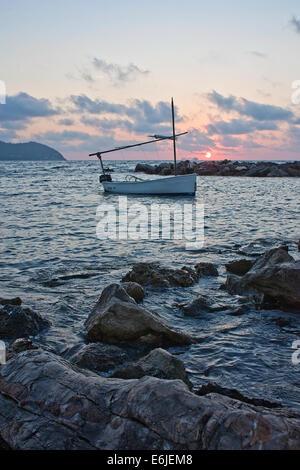 Boat at sunrise, Majorca - Stock Image