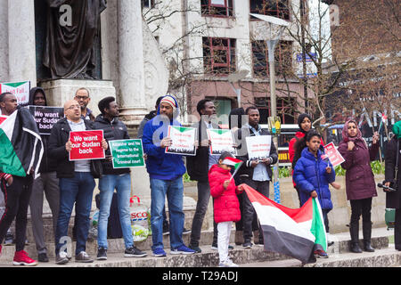 Manchester, UK. 31st Mar, 2019. Manchester, UK.  31st March 2019. Protestors in Manchester's Piccadilly Gardens stage a demonstration opposing Sudan's President Omar-al-Bashir, calling for him to submit to the International Criminal Court (ICC) for crimes allegedly committed in Darfur region. Sudan denies any atrocities and says it does not recognise the ICC. President Bashir,who took power in a 1989  military coup, has defied opposition calls to step down in the face of economic hardship in Sudan. Credit: JY News Images/Alamy Live News - Stock Image