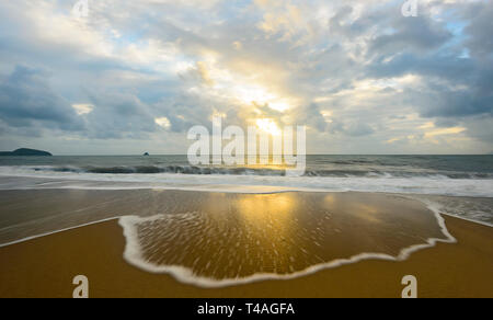Delicate wave spume and patterns at sunrise, Palm Cove, Cairns Northern Beaches, Far North Queensland, FNQ, QLD, Australia - Stock Image
