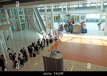 Aeroporto Francisco sa Carneiro interior and passengers queueing waiting in line with luggage in Porto Portugal EU  KATHY DEWITT - Stock Image