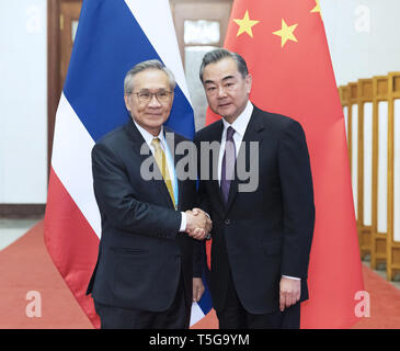 Beijing, China. 24th Apr, 2019. Chinese State Councilor and Foreign Minister Wang Yi (R) meets with Thai Foreign Minister Don Pramudwinai in Beijing, capital of China, April 24, 2019. Credit: Liu Bin/Xinhua/Alamy Live News - Stock Image