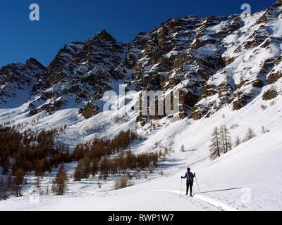 Snowshoeing beneath Pic de Château Renard, Parc regional du Queyras, French Alps - Stock Image
