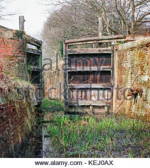 Derelict lock on the Basingstoke Canal;  Deepcut Locks, Pirbright, Surrey England UK, – 1969 - Stock Image