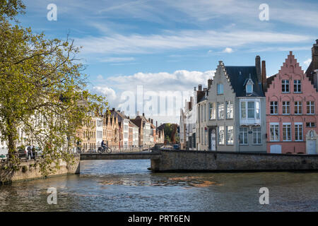 Street scene of canal waterfront housing in the historic city of Bruges, Flanders, Belgium - Stock Image
