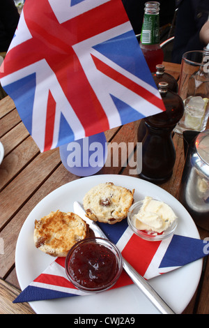 A traditional English cream tea during the Queen's Diamond Jubilee - Stock Image