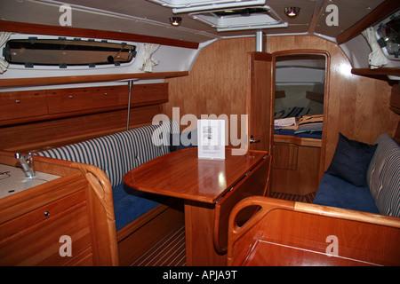 wooden salon on a sailing yatch - Stock Image