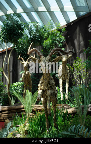 Wooden sculpture/carving of Springbok in flight, in Gardens by the Bay, Singapore - Stock Image