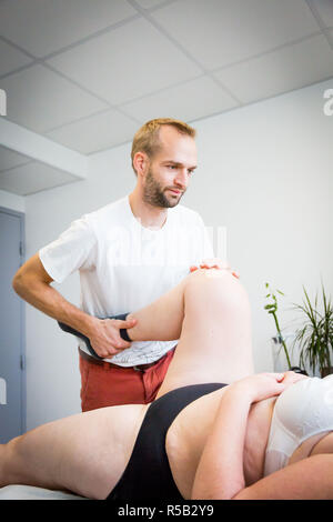 Physiotherapy session, Geveze, France. - Stock Image
