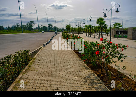 Flowers line a wide boulevard and motorway along the seashore in Malabo, the capital of Equatorial Guinea, which has invested heavily in infrastructur - Stock Image