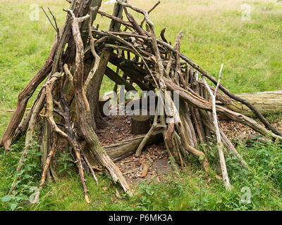 Small children's play den made of branches sticks and twigs - Stock Image