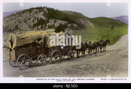 Horse-drawn freight wagons in the Early Days on the Cariboo Highway, Near Lytton, British Columbia, Canada. - Stock Image