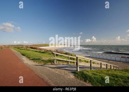 dike,dunes,beach with beach crossing and north sea in westkapelle,walcheren,zeeland,southern netherlands - Stock Image