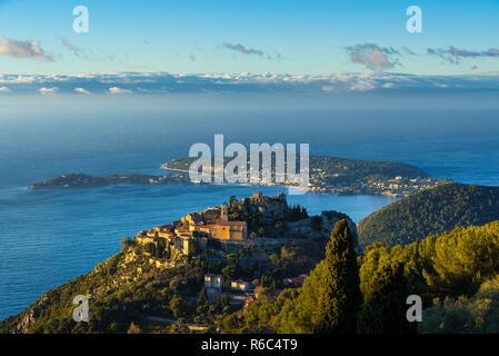 Eze (Èze) Village, the Mediterranean Sea and Saint-Jean-Cap-Ferrat at sunrise. Alpes-Maritimes, French Riviera, France - Stock Image