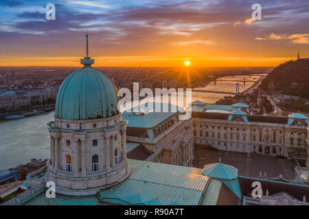 Budapest, Hungary - Aerial view of the dome of Buda Castle Royal palace at sunrise with Liberty Bridge, Elisabeth Bridge and Statue of Liberty - Stock Image