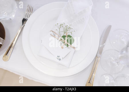 Wedding place setting with napkin on plate - Stock Image