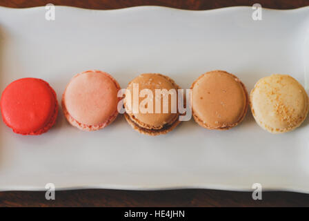 Five macaroons in a line - Stock Image
