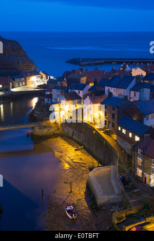 United Kingdom, England, North Yorkshire, Staithes. The harbour at dusk. - Stock Image
