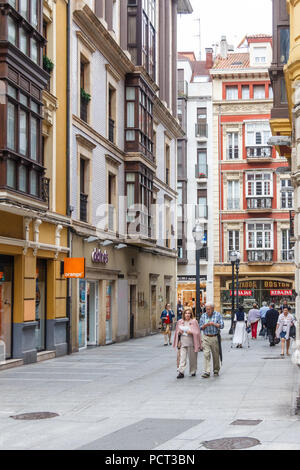 Gijon, Spain - 6th July 2018: Shoppers on the Calle Corrida. This is one of the main shopping streets. - Stock Image