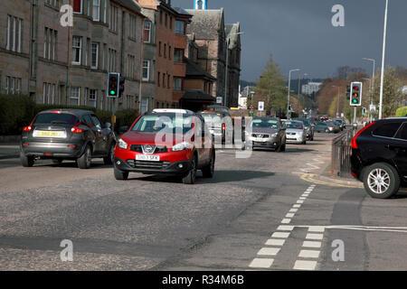 Traffic in a suburb of Edinburgh - Stock Image