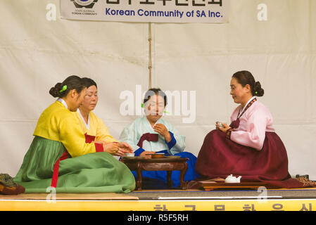 A group of women participate in a traditional tea ceremony at the 2017 Korean Culture and Food Festival in Adelaide, South Australia, Australia. - Stock Image