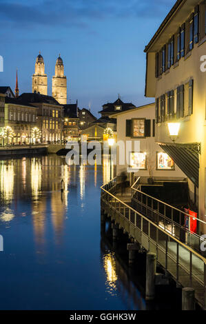 River Limmat and Grossmunster at dusk, Zurich, Switzerland - Stock Image