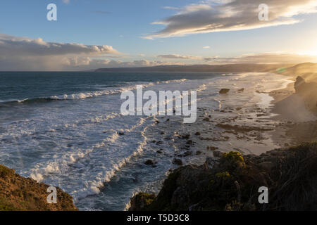 Sunset view of beach and cliffs at Aireys Inlet along the Great Ocean Road, Victoria, Australia - Stock Image