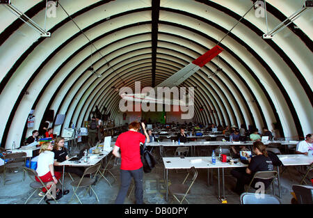 Participants of the 'Chaos Communication Camp 2007' have assembled workstations inside a former airplane - Stock Image