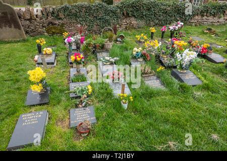 Flowers,on,Graves,Churchyard,Cemetery,Gravestones - Stock Image