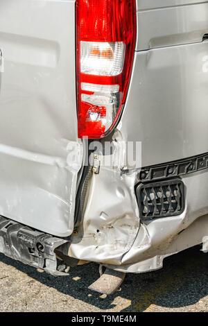 Damaged rear end and lights of a ban after an accident - Stock Image