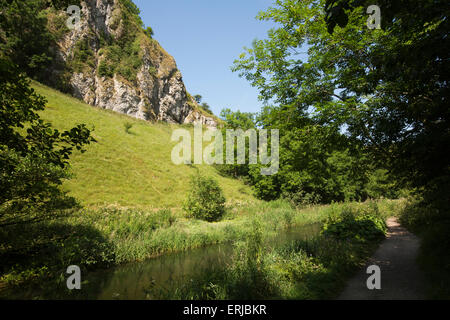 UK, England, Derbyshire, Dovedale, River Dove, flowing past Raven's Tor - Stock Image