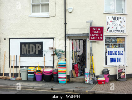 Traditional old hardware store with buckets and brushes for sale outside the shop in the Shropshire market town of Oswestry Shropshire England - Stock Image