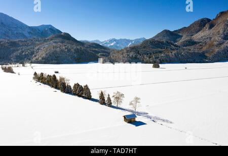 Germany, Upper Bavaria, Werdenfelser Land, near Eschenlohe, winter landscape, Aerial view of shack - Stock Image